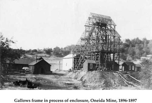 Gallows frame in process of enclosure, Oneida Mine, 1896-1897